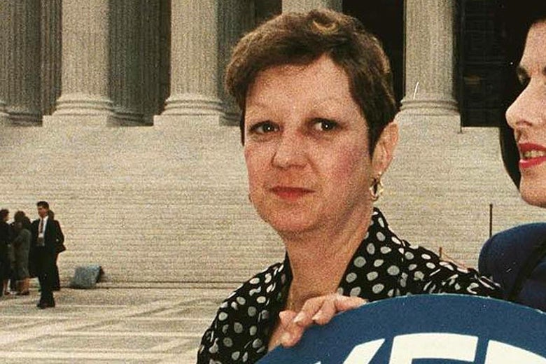 Norma McCorvey looking at the camera in front of the Supreme Court building.