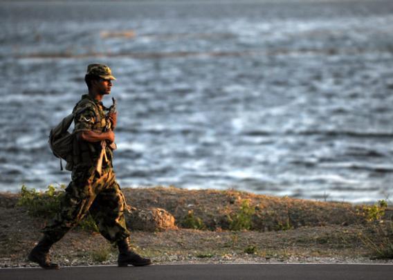 A Sri Lankan army trooper patrols the island's northern town of Jaffna.