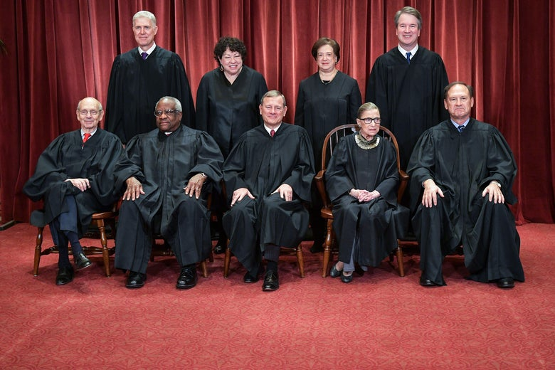 Neil Gorsuch, Sonia Sotomayor, Elena Kagan, and Brett Kavanaugh standing, and Stephen Breyer, Clarence Thomas, John Roberts, Ruth Bader Ginsburg, and Samuel Alito seated, all in their robes