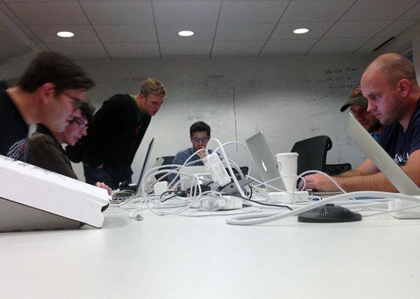 Slate Dev team, Dan Check, Chase Felker, Chris Schieffer, Brandon Long, David Stern and Jon Lechliter huddling the weekend before launch.
