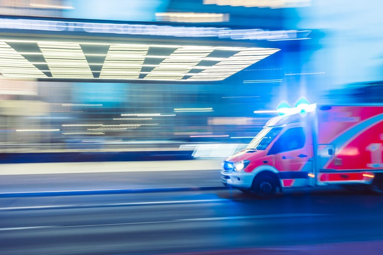 An ambulance with lights on in a time-lapse image