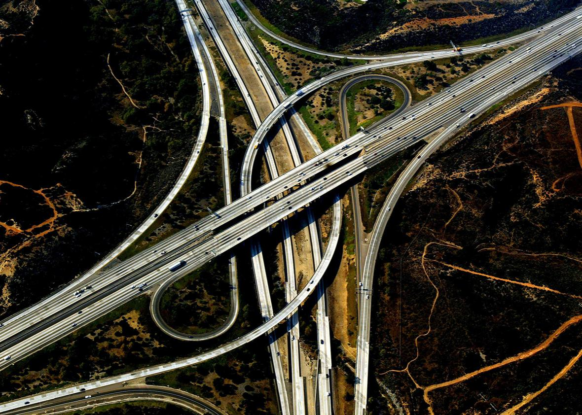 A freeway interchange with burnt fields nearby is seen in this aerial view October 30, 2003, in San Diego