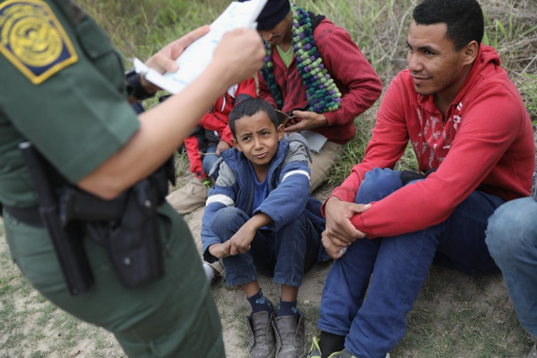 A U.S. Border Patrol agent checks birth certificates while taking Central American immigrants into detention on January 4, 2017 near McAllen, Texas.
