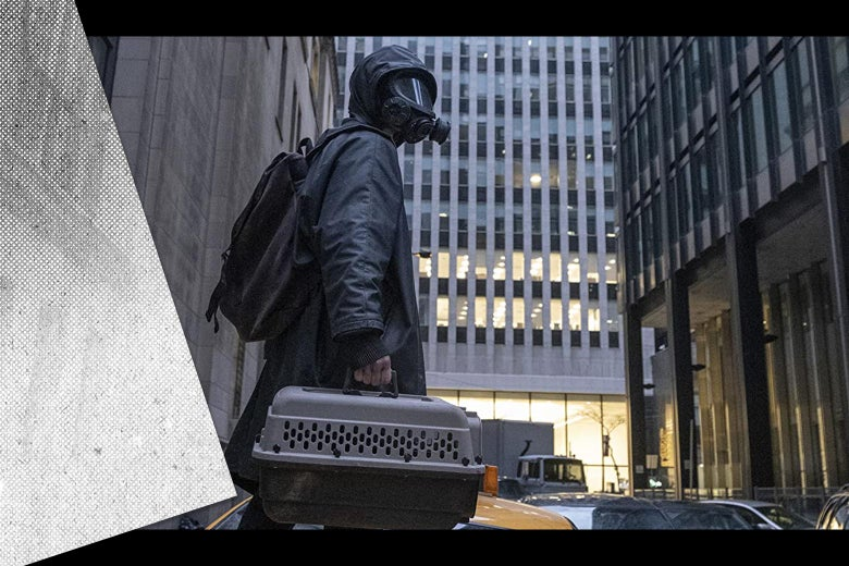 Still from the TV show of Yorick wearing a gas mask and poncho standing in an empty city street, with a black-and-white hand-drawn comic panel overlaid on the side of a skyscraper in the background