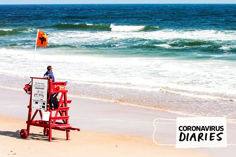 A lifeguard on a stand at the beach in Florida.