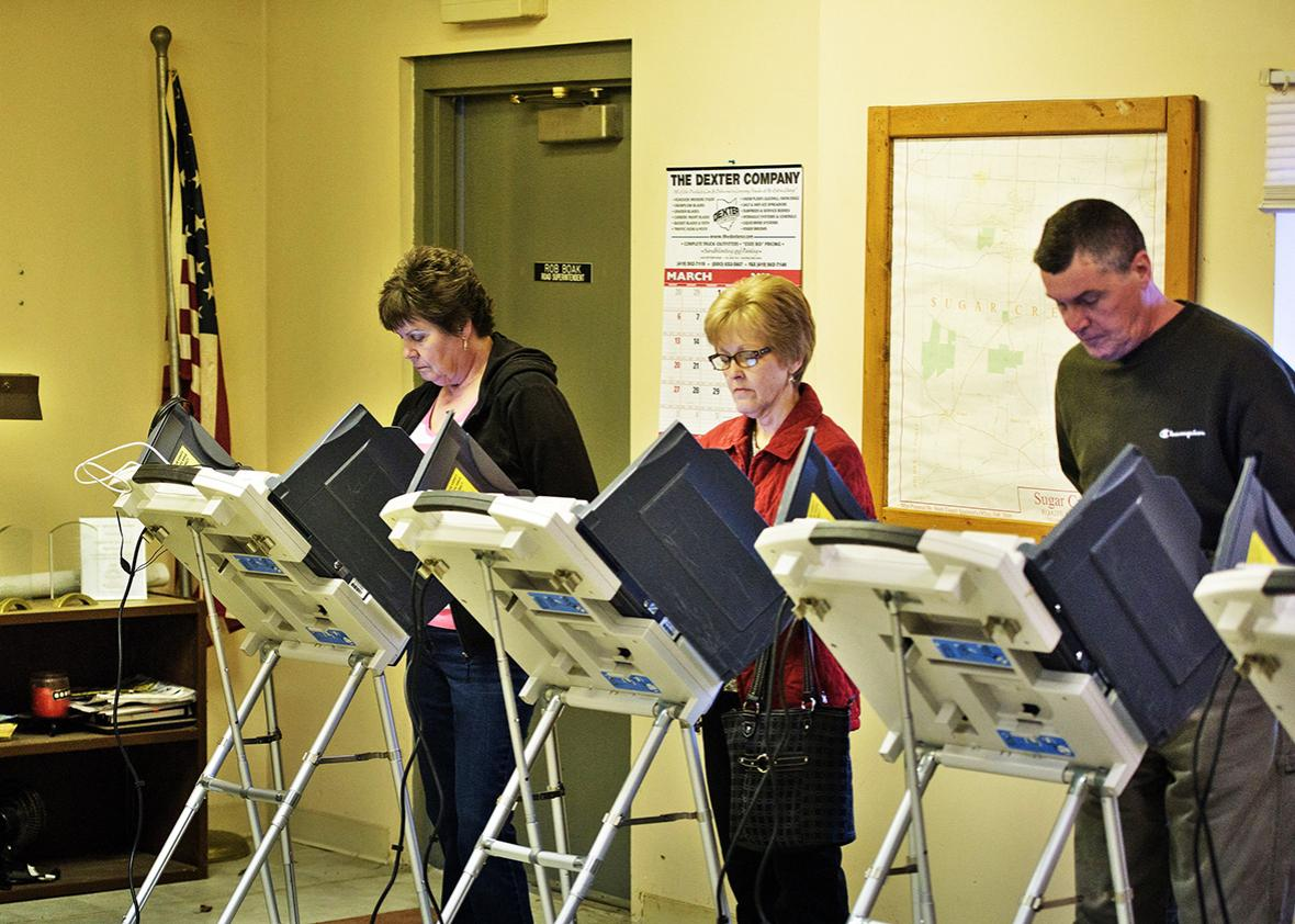 Voters use electronic machines to vote at a polling place during primary voting in Stark County March 15, 2016 in Beach City, Ohio.