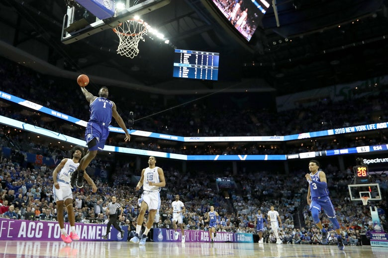 CHARLOTTE, NORTH CAROLINA - MARCH 15: Zion Williamson #1 of the Duke Blue Devils dunks the ball against the North Carolina Tar Heels during their game in the semifinals of the 2019 Men's ACC Basketball Tournament at Spectrum Center on March 15, 2019 in Charlotte, North Carolina.  (Photo by Streeter Lecka/Getty Images)