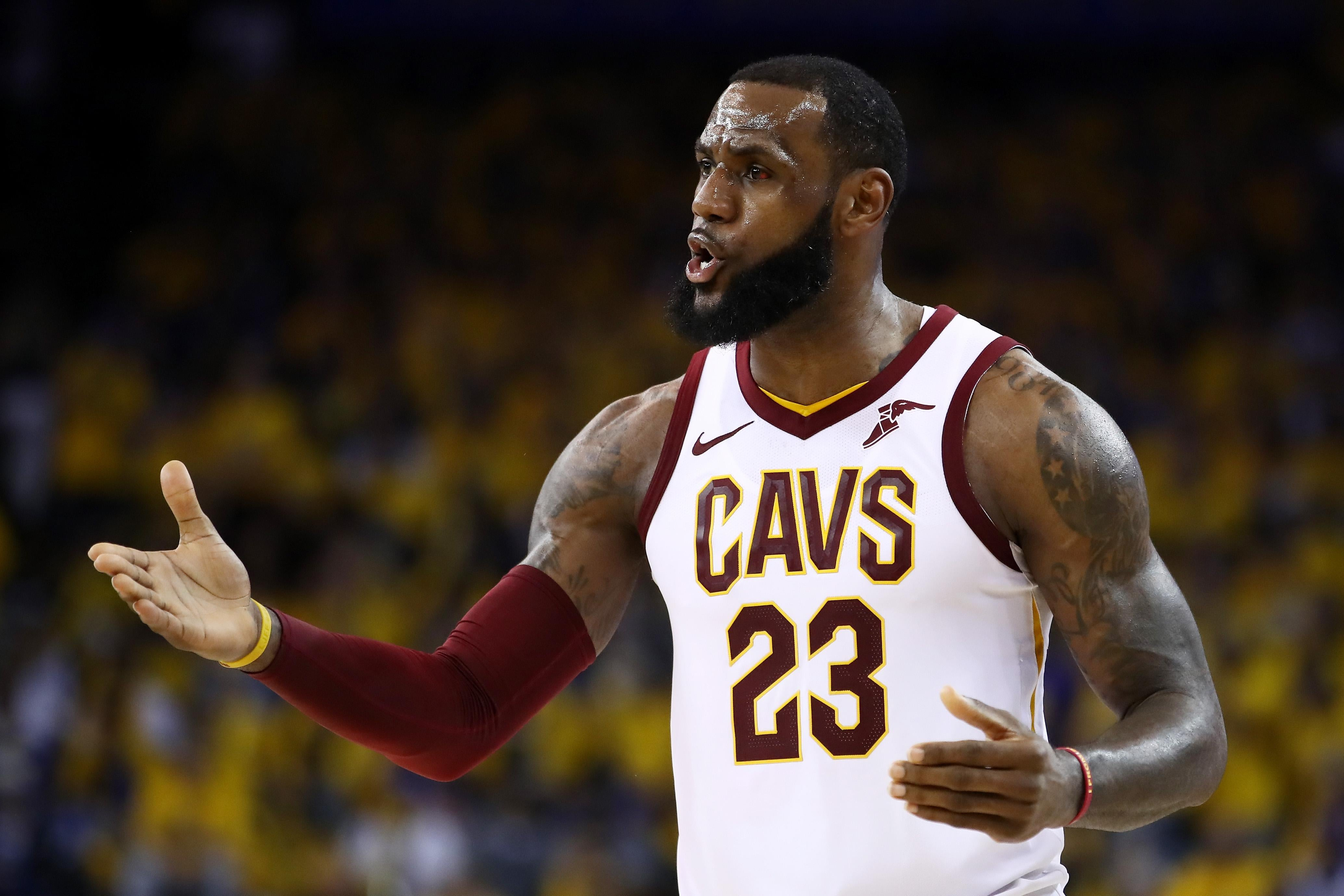 LeBron James #23 of the Cleveland Cavaliers reacts against the Golden State Warriors in Game 2 of the 2018 NBA Finals at ORACLE Arena on June 3, 2018 in Oakland, California.