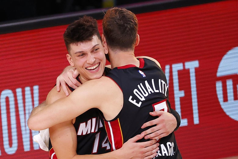 LAKE BUENA VISTA, FLORIDA - SEPTEMBER 23: Tyler Herro #14 of the Miami Heat and Goran Dragic #7 of the Miami Heat react after their win over the Boston Celtics in Game Four of the Eastern Conference Finals during the 2020 NBA Playoffs at AdventHealth Arena at the ESPN Wide World Of Sports Complex on September 23, 2020 in Lake Buena Vista, Florida. NOTE TO USER: User expressly acknowledges and agrees that, by downloading and or using this photograph, User is consenting to the terms and conditions of the Getty Images License Agreement.  (Photo by Kevin C. Cox/Getty Images)