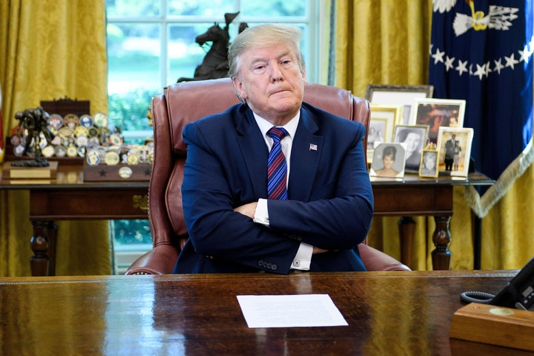 President Donald Trump pauses while talking to reporters in the Oval Office on July 26, 2019, in Washington, D.C.