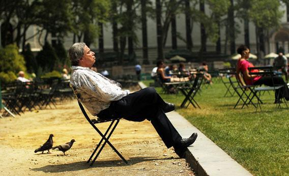 A man takes a break in Bryant Park during a heat wave on June 9, 2011 in New York City.