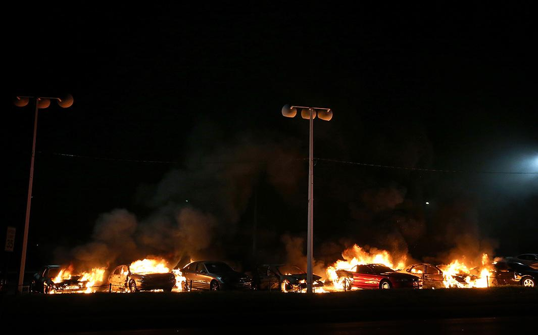 A row of cars burn at a used car lot during a demonstration on Nov. 25, 2014, in Ferguson, Missouri