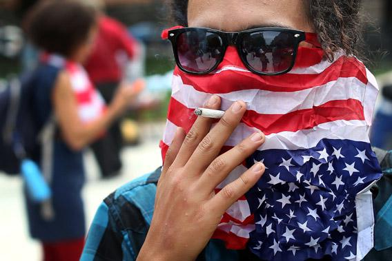 A member of Occupy DC smokes a cigarette after a march to mark the first anniversary of the movement.
