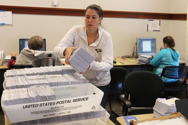 Thousands of ballots sit in boxes as Utah County election workers process the mail-in ballots. Utah conducts elections entirely by mail.