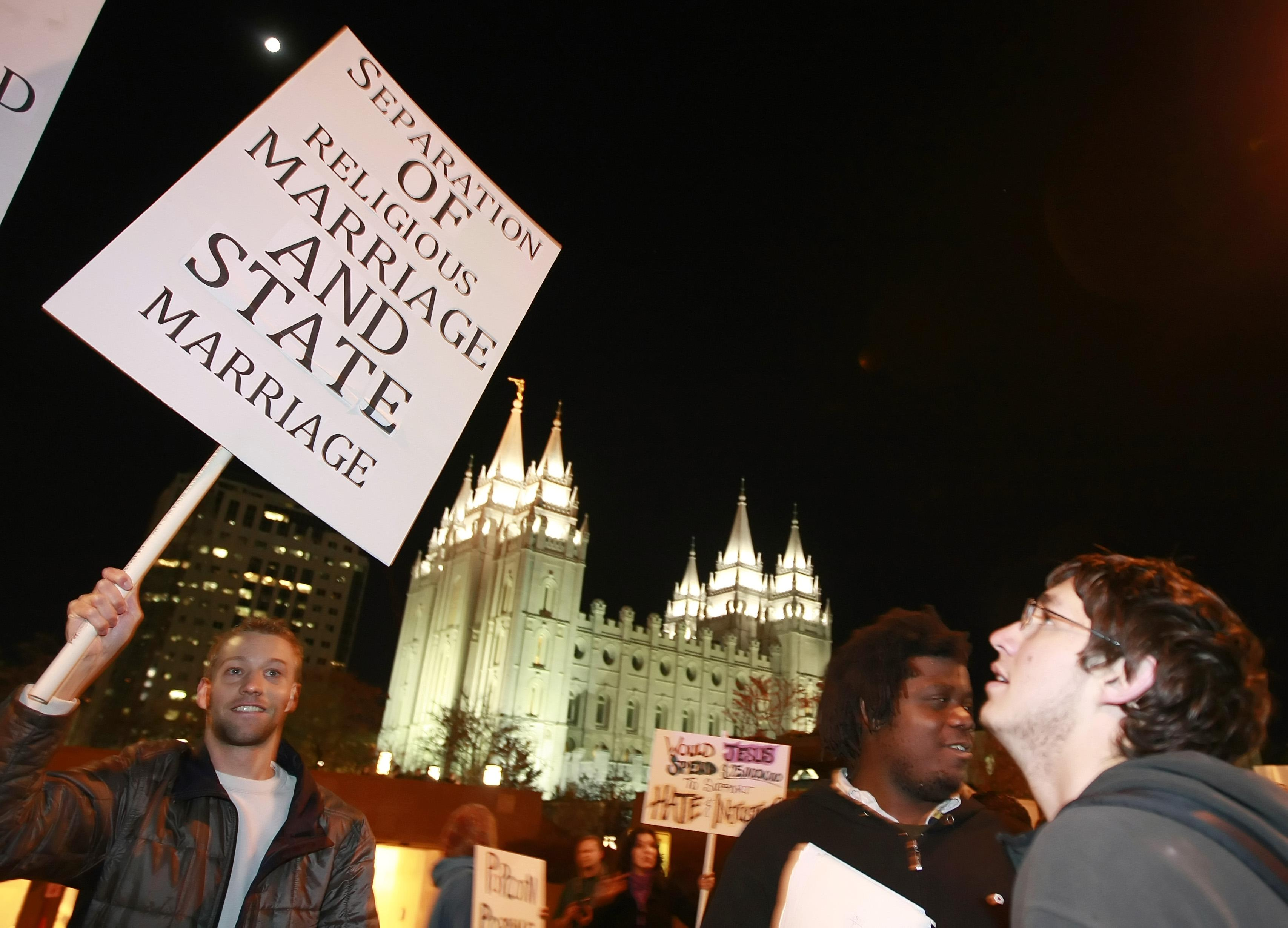 Jay Christian, left, and thousands of other people protest against the passage of California's Proposition 8 outside the world headquarters of Temple of the Church of Jesus Christ of Latter Day Saints.