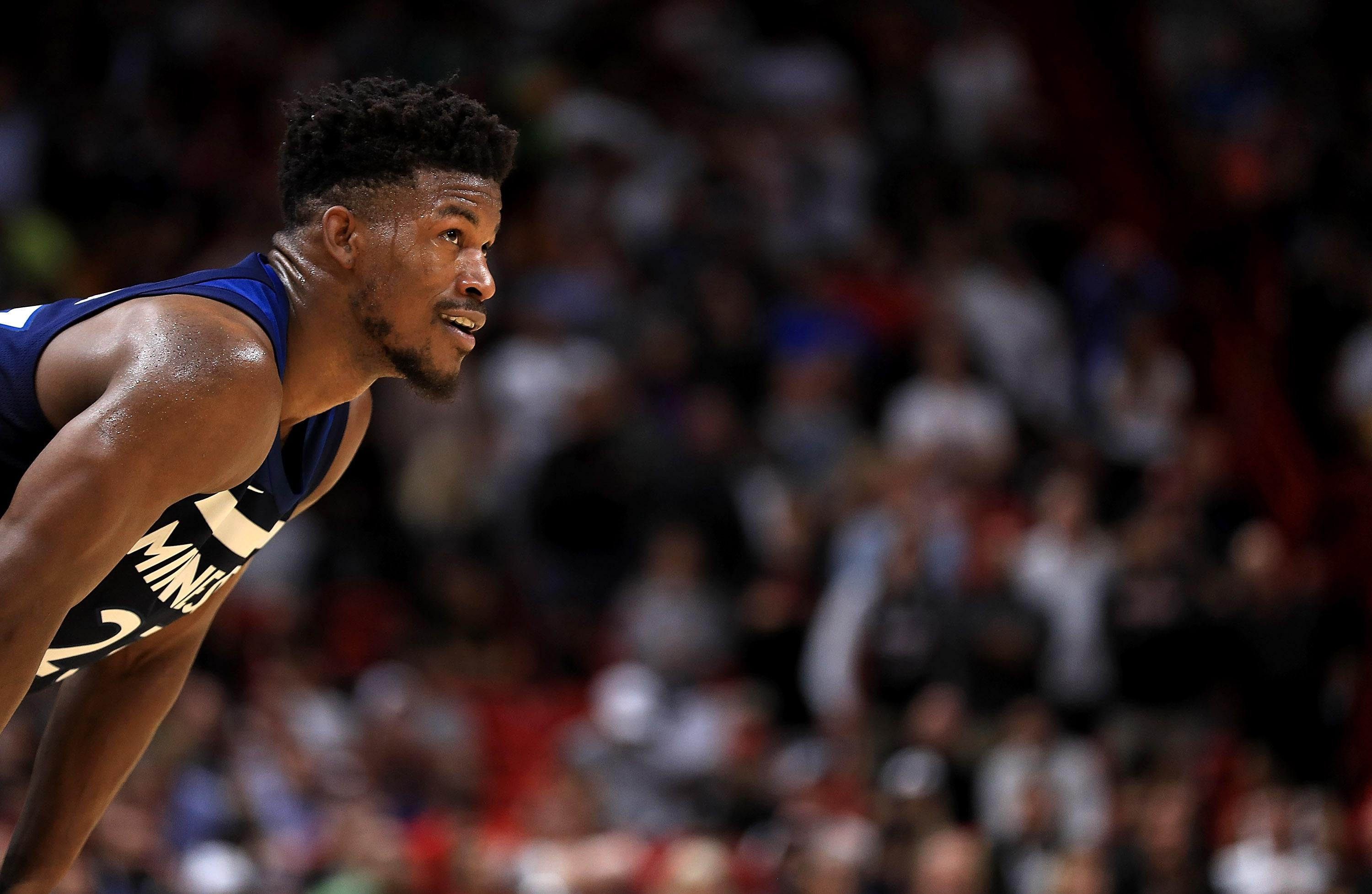 MIAMI, FL - OCTOBER 30:  Jimmy Butler #23 of the Minnesota Timberwolves looks on during a game against the Miami Heat at American Airlines Arena on October 30, 2017 in Miami, Florida. NOTE TO USER: User expressly acknowledges and agrees that, by downloading and or using this photograph, User is consenting to the terms and conditions of the Getty Images License Agreement.  (Photo by Mike Ehrmann/Getty Images)