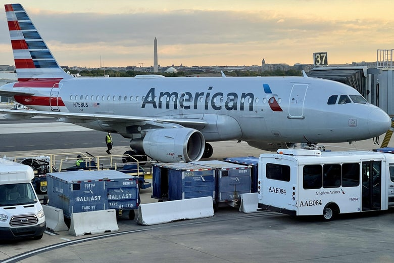 An American Airlines plane is seen at sunrise on the tarmac of the Reagan Washington National Airport (DCA) in Arlington, Virginia, on April 22, 2021.