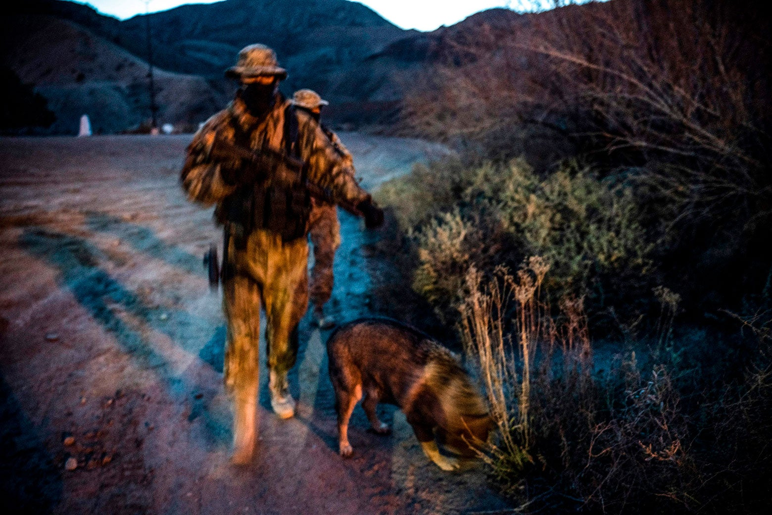 Viper and Stinger, members of the Constitutional Patriots New Mexico Border Ops Team militia who use aliases to protect their identity, patrol the U.S.-Mexico border in Sunland Park, New Mexico on March 20.
