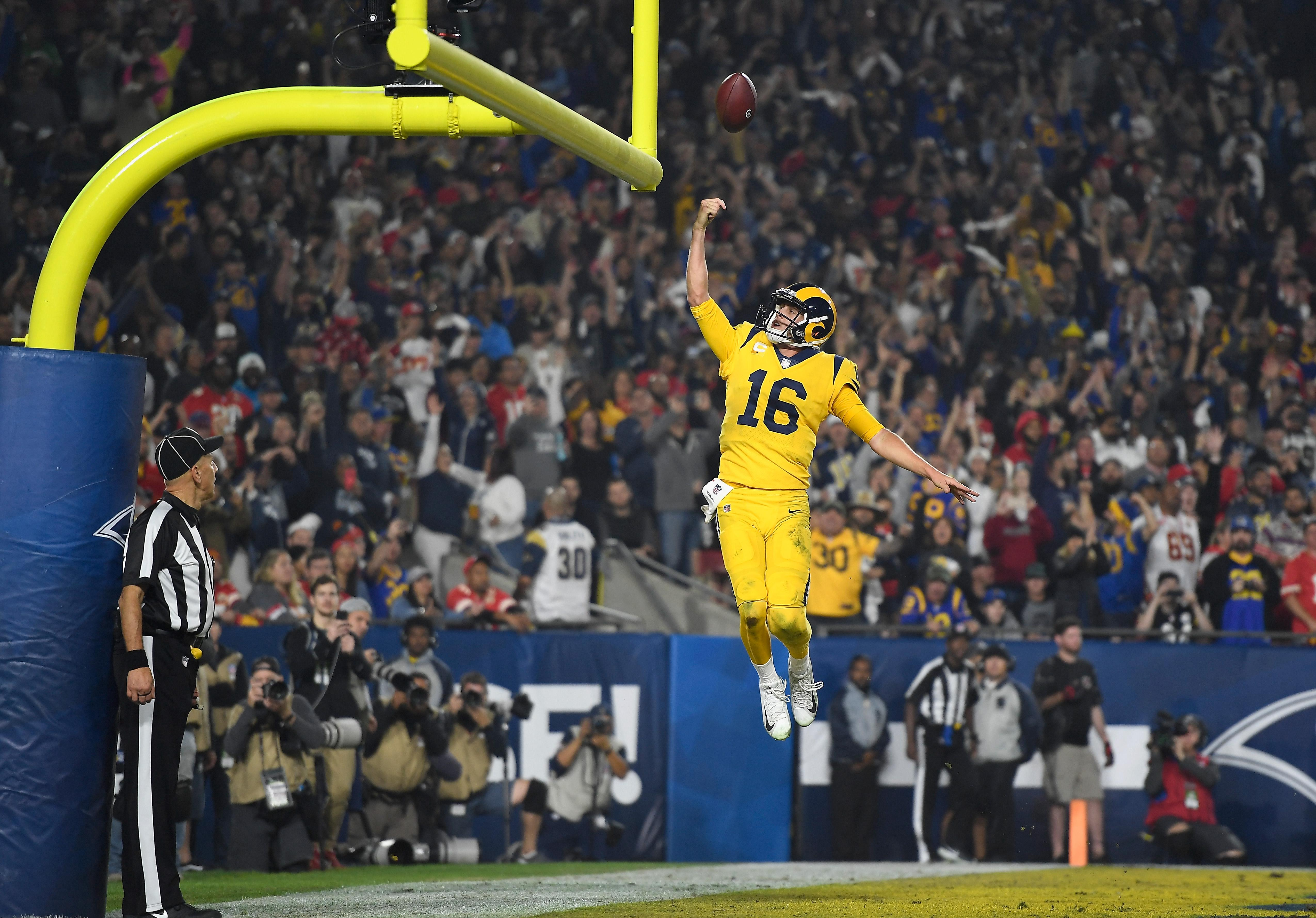 LOS ANGELES, CA - NOVEMBER 19:  Quarterback Jared Goff #16 of the Los Angeles Rams celebrates his touchdown on a seven yard rush by dunking the football between the goal posts during the third quarter of the game against the Kansas City Chiefs at Los Angeles Memorial Coliseum on November 19, 2018 in Los Angeles, California.  (Photo by Kevork Djansezian/Getty Images)