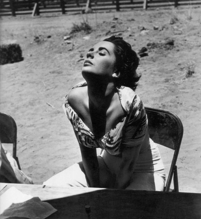 Sid Averey. Elizabeth Taylor sunning herself on the set of 'Giant', Marfa, Texas, 1955