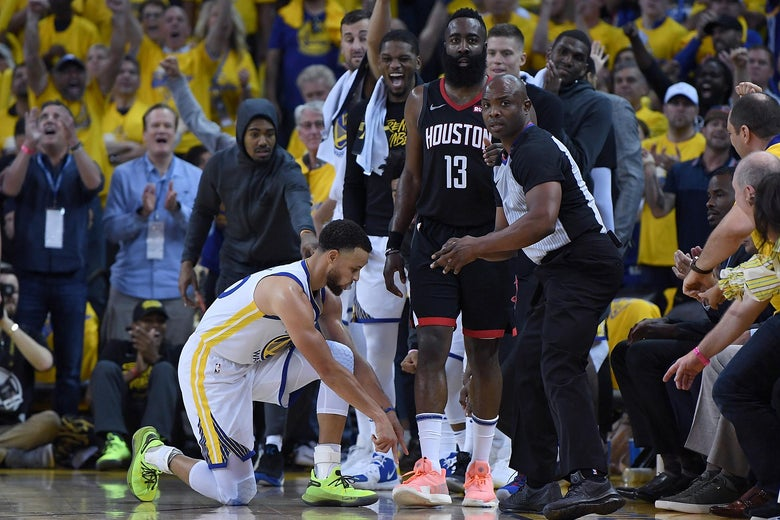 Stephen Curry points to the floor after James Harden's shot attempt in Oakland on Sunday.