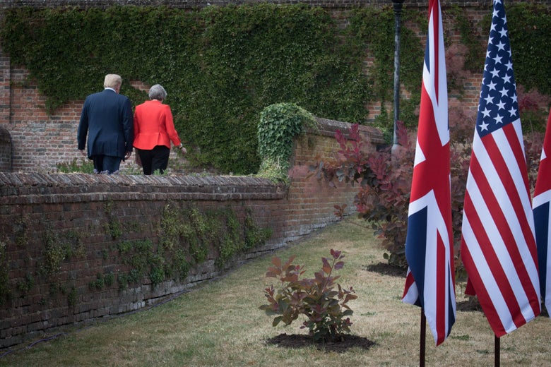 Prime Minister Theresa May and U.S. President Donald Trump leave after a joint press conference following their meeting at Chequers on July 13, 2018 in Aylesbury, England.