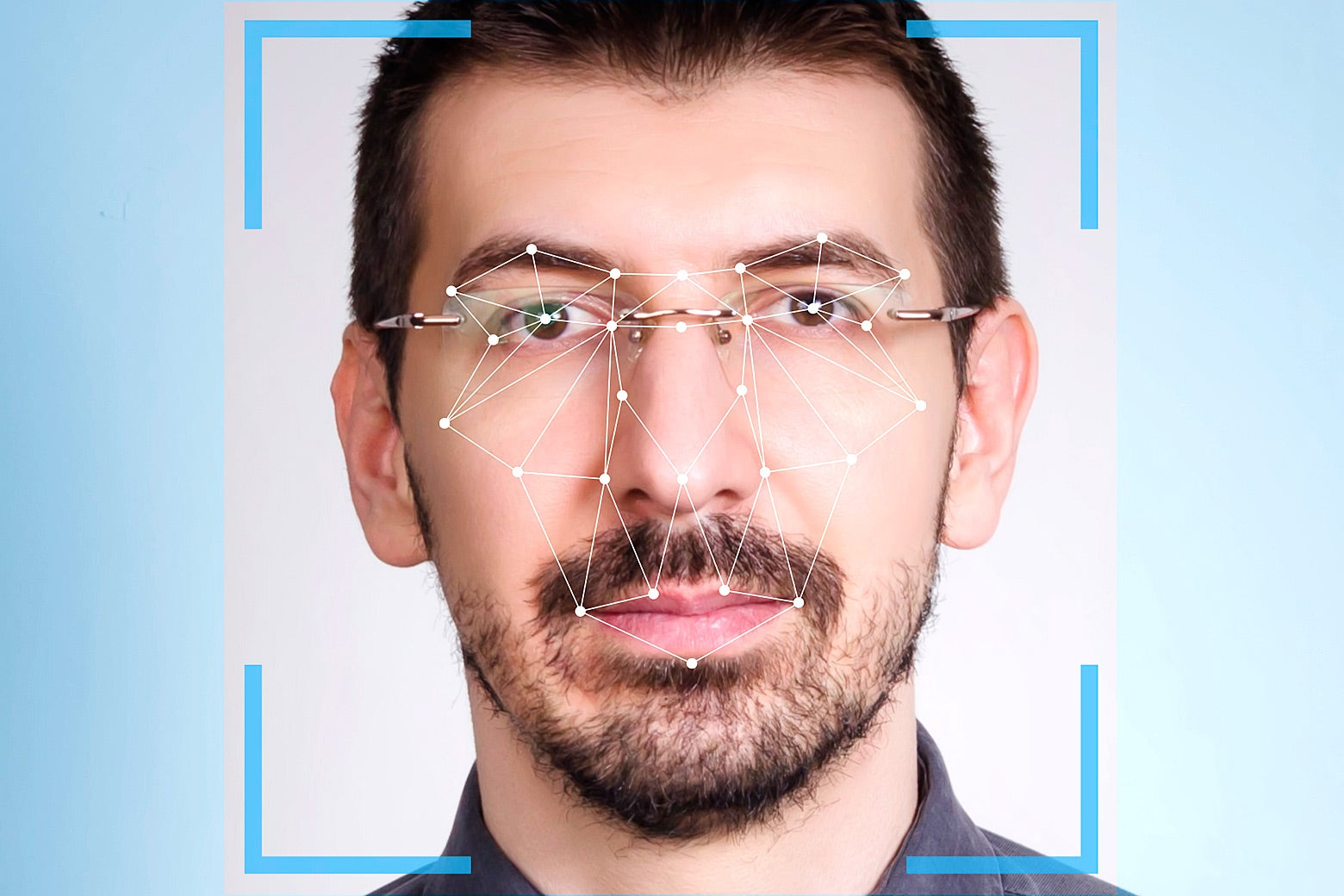 A man's face is focused on by facial recognition software.