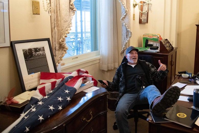 Richard Barnett sits inside the office of Speaker of the House Nancy Pelosi in Washington, D.C. on January 6, 2021.