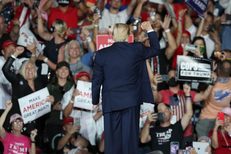 President Donald Trump waves to the crowd as he leaves after speaking during a campaign event at the Orlando Sanford International Airport on October 12, 2020 in Sanford, Florida.