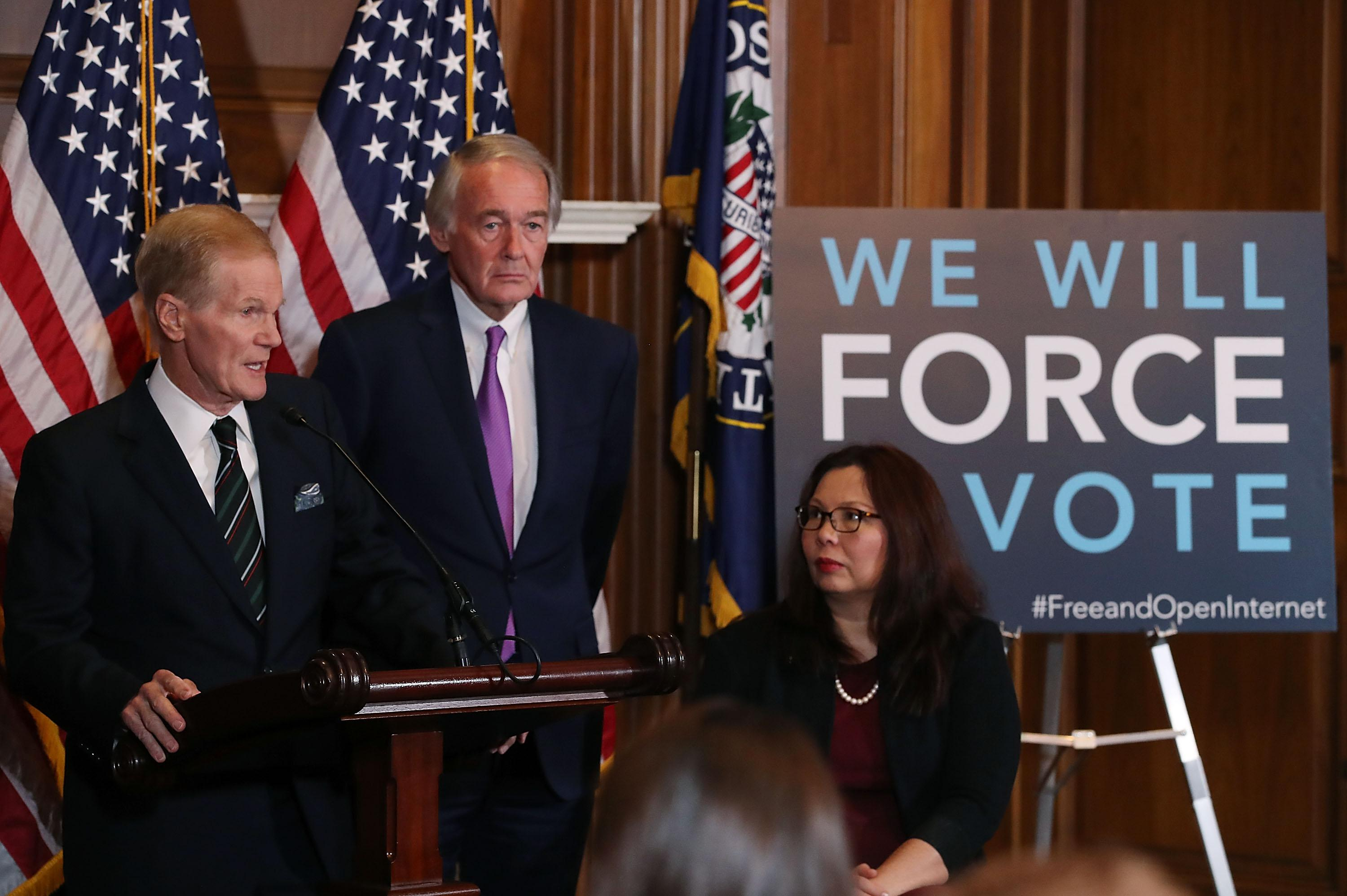 WASHINGTON, DC - JANUARY 09:  Sen. Bill Nelson (D-FL) (L) is flanked by Ed Markey (D-MA) and  Tammy Duckworth (D-IL)while speaking about a Congressional Review Act (CRA) resolution that would undo action by the FCC and restore the 2015 net neutrality rules, on Capitol Hill January 9, 2018 in Washington, DC.  (Photo by Mark Wilson/Getty Images)