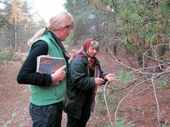 """Author Mary Mycio (L) author of """"Wormwood Forest: A Natural History of Chernobyl"""" with Valentina, 65, pointing out the healing herbs in a special spot of the forest."""