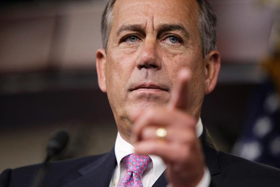 House Speaker John Boehner (R-OH) takes a question from a reporter during a news conference.