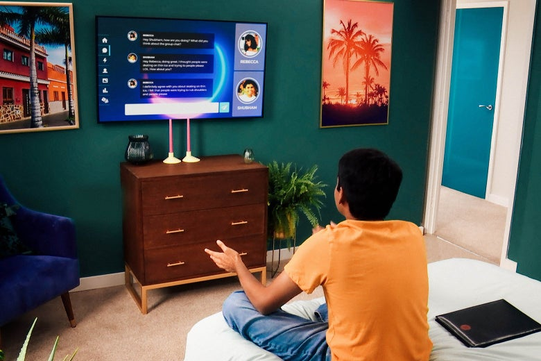 The back of a man named Shubham, sitting on his bed and looking at a screen displaying the Circle.