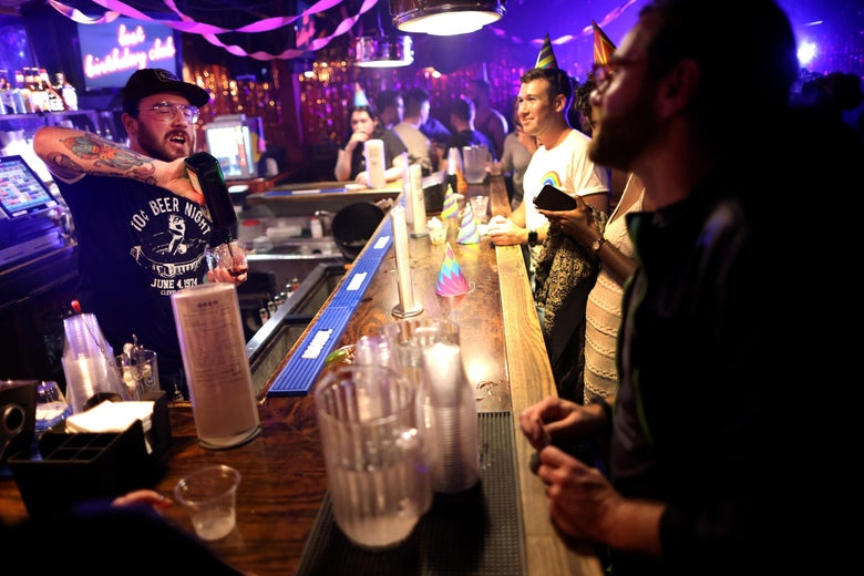 Patrons order drinks at DC9 nightclub during their Lost Birthday Club dance party on June 11, 2021 in Washington, DC. Washington, D.C. lifted pandemic capacity limits for bars, nightclubs and music venues allowing for full capacity