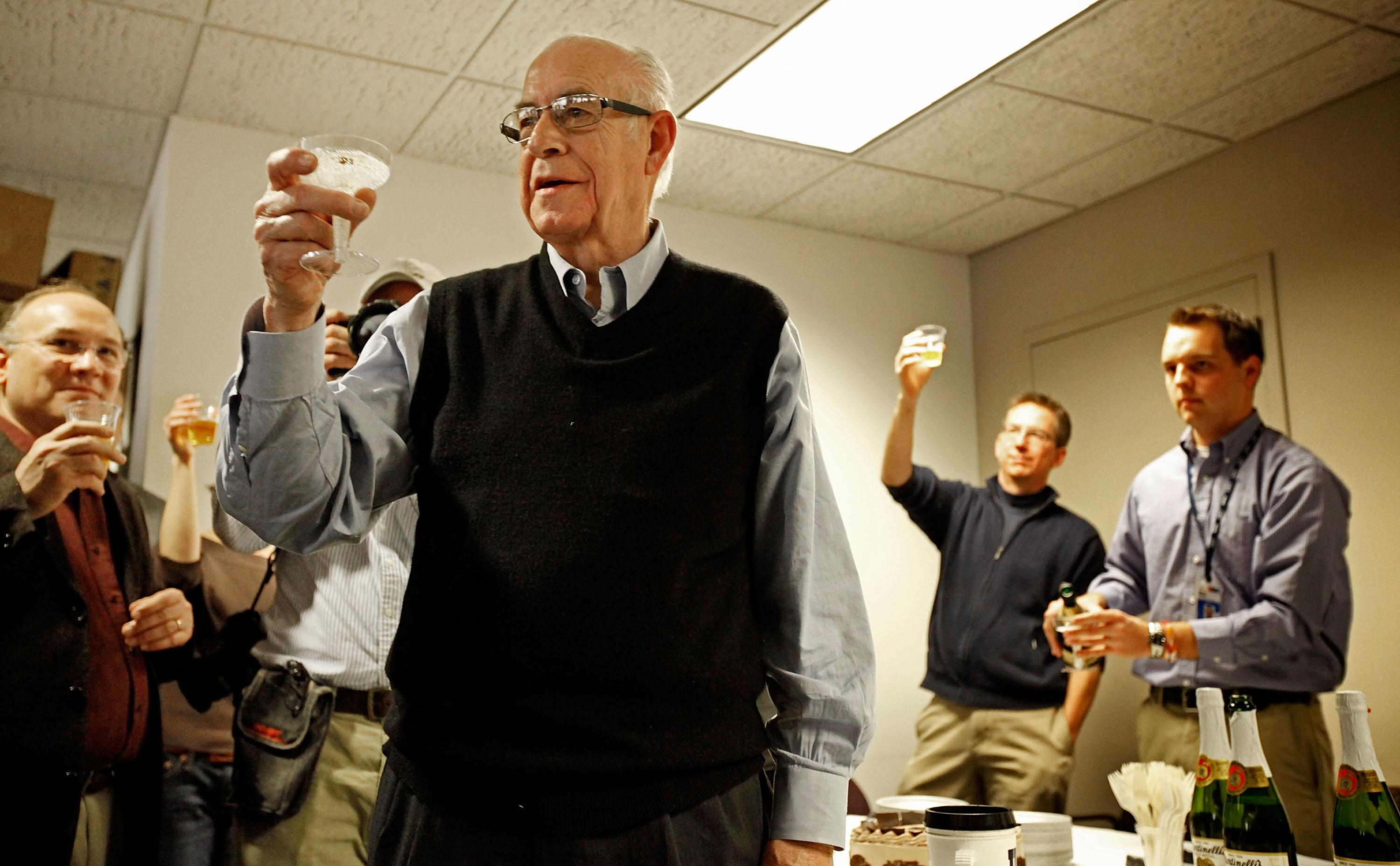 National Public Radio's Carl Kasell lifts a glass to toast his co-workers after delivering his last newscast at NPR December 30, 2009 in Washington, DC. A newscaster with NPR for 30 years, Kasell will take up the duty of roving ambassador for the network and continue his work on the game show Wait, Wait... Don't Tell Me!