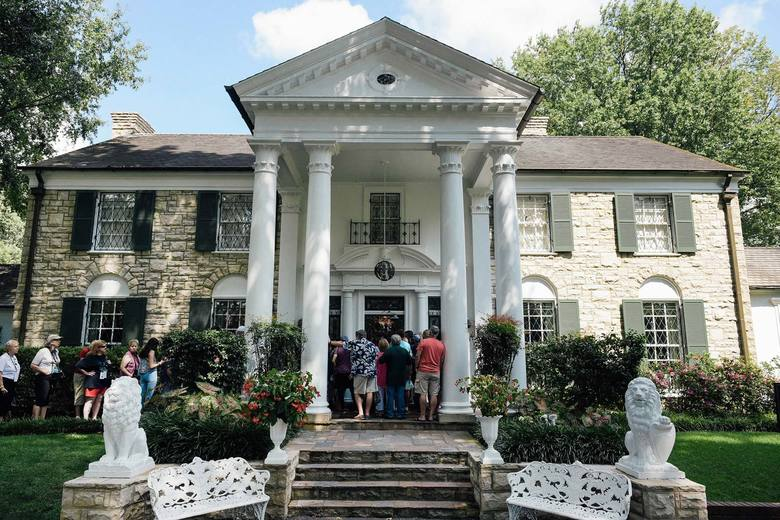 People wait to enter the Mansion at Graceland in Memphis, Tennessee.