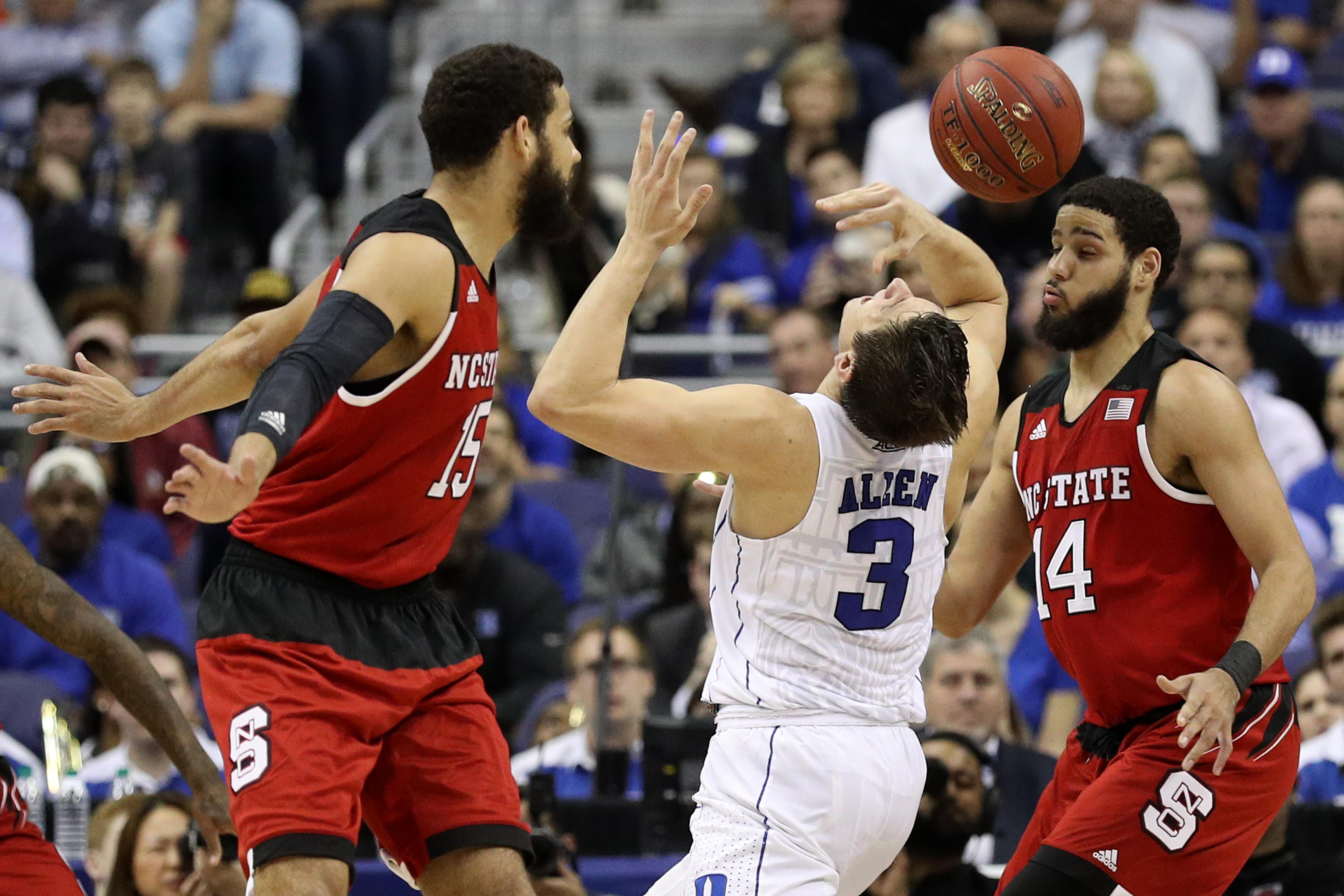 WASHINGTON, DC - MARCH 09: Grayson Allen #3 of the Duke Blue Devils looses poession of the ball as he dribbles between Cody Martin #15 and Caleb Martin #14 of the North Carolina State Wolfpack during the second half in the second round of the 2016 ACC Basketball Tournament at Verizon Center on March 9, 2016 in Washington, DC. The Duke Blue Devils won, 92-89. (Photo by Patrick Smith/Getty Images)