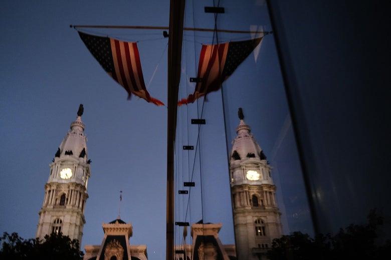 The American flag hangs from a building near Philadelphia City Hall on November 04, 2020 in Philadelphia, Pennsylvania.