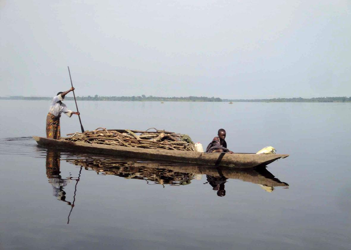 Pirogue transporting wood, Congo River, DRC, April 5, 2015.