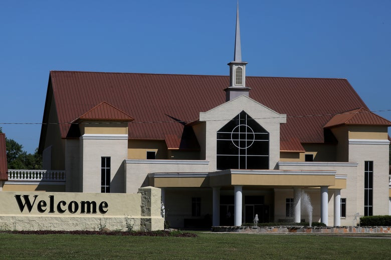 Exterior of church with welcome sign out front
