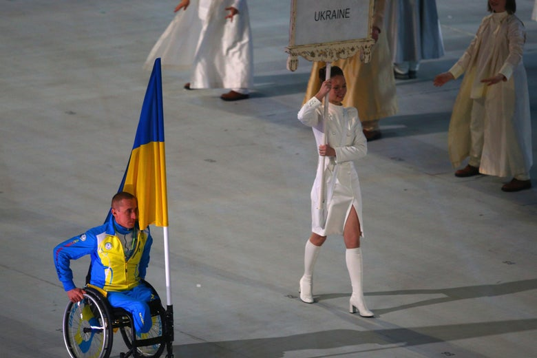 Mykailo Tkachenko of Ukraine bears the flag during the opening ceremony of the Sochi 2014 Paralympic Winter Games at Fisht Olympic Stadium.