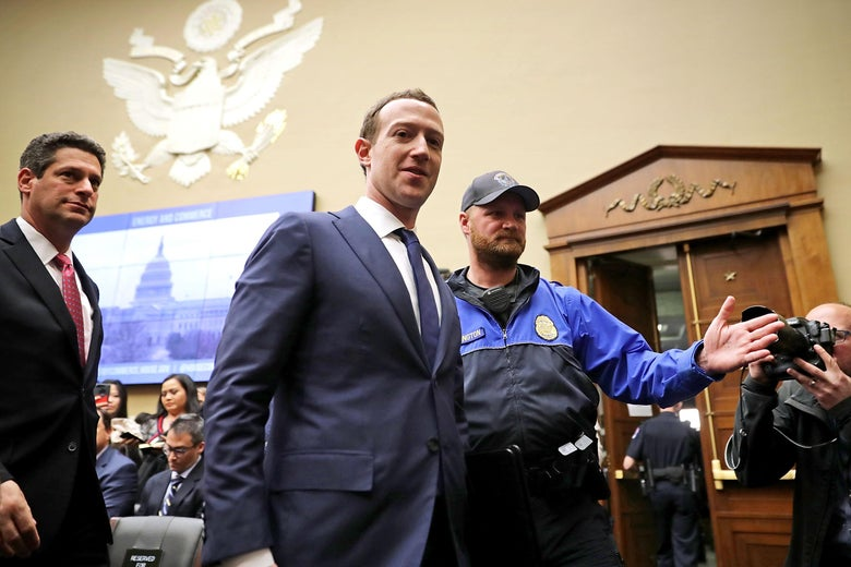 WASHINGTON, DC - APRIL 11:  Facebook co-founder, Chairman and CEO Mark Zuckerberg (C) leaves during a break in a hearing of the House Energy and Commerce Committee in the Rayburn House Office Building on Capitol Hill April 11, 2018 in Washington, DC. This is the second day of testimony before Congress by Zuckerberg, 33, after it was reported that 87 million Facebook users had their personal information harvested by Cambridge Analytica, a British political consulting firm linked to the Trump campaign.  (Photo by Chip Somodevilla/Getty Images)