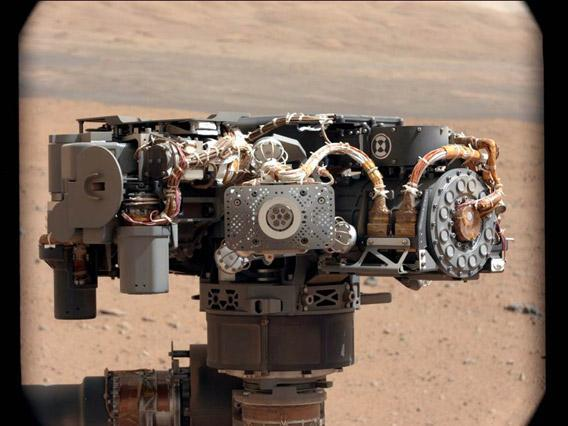 The Alpha Particle X-Ray Spectrometer (APXS) on NASA's Curiosity rover, with the Martian landscape in the background.