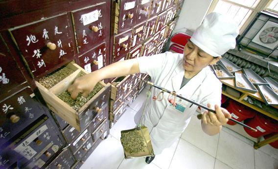 A doctor prepares a Chinese herbal medicine.