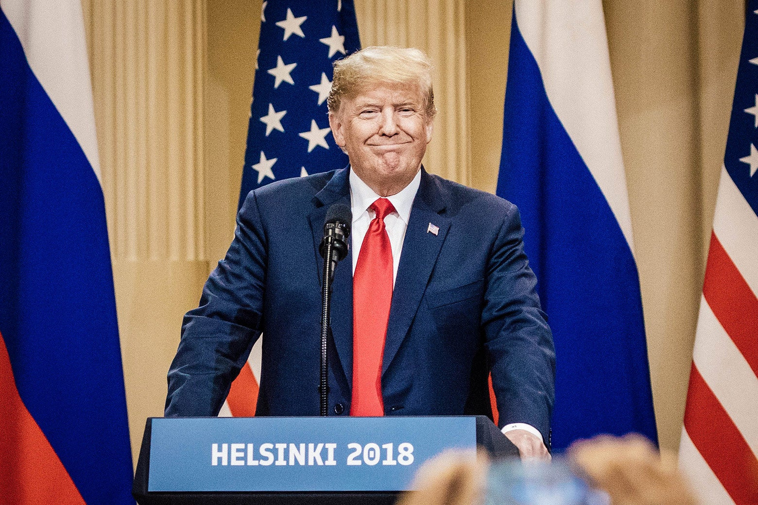 Donald Trump smirks at a press conference in Helsinki.