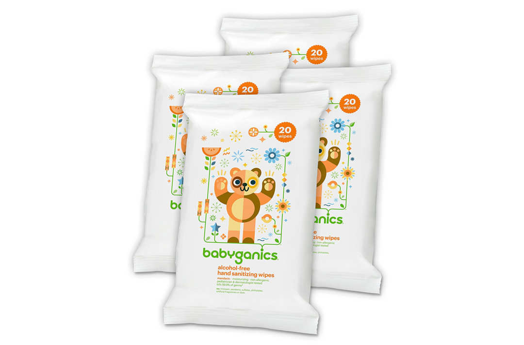 Three Babyganics packs of hand sanitizing wipes.
