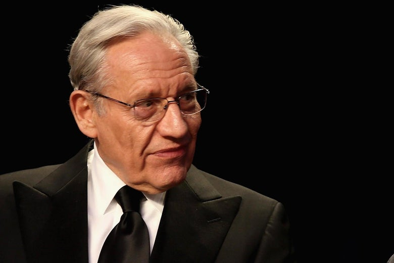 Woodward in a suit and tie looking to his left