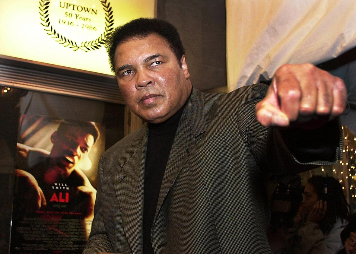"Former heavyweight boxing champ Muhammad Ali throws a punch as he poses for photographers on his arrival at the Uptown Theatre in Washington, DC, for the premiere of ""Ali"", the screen biography of his life, 17 December, 2001."