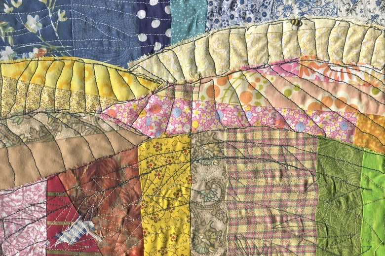 A patchwork quilt in many colors