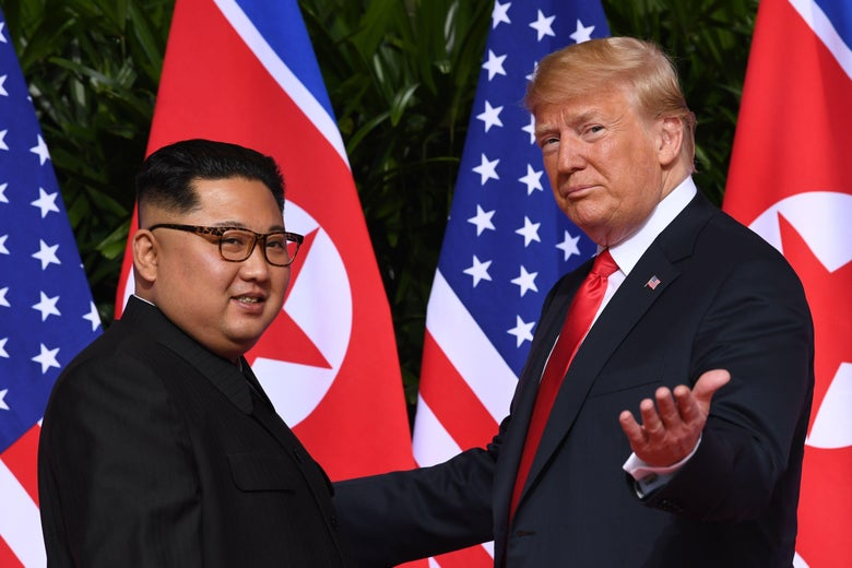 President Donald Trump gestures as he meets with North Korea's leader Kim Jong Un at the start of their historic US-North Korea summit, at the Capella Hotel on Sentosa island in Singapore on June 12, 2018.